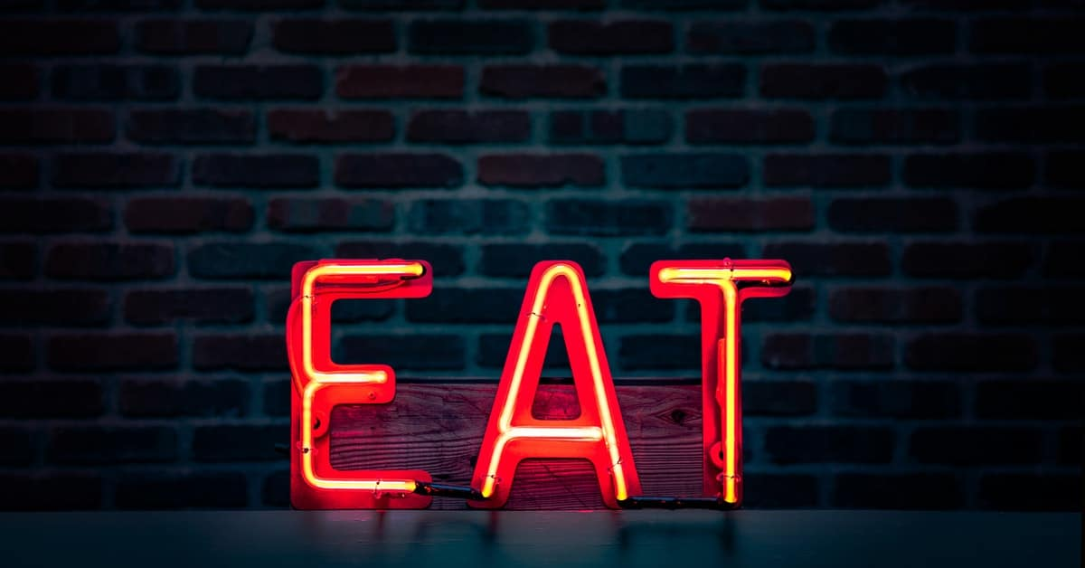 Neon sign that says EAT