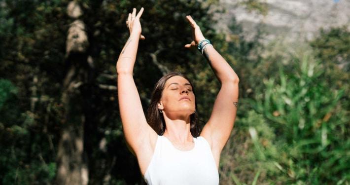 Woman breathing in a garden