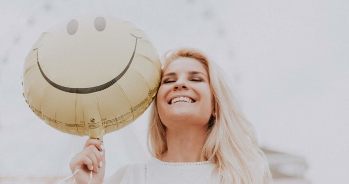 Girl smiling with balloon