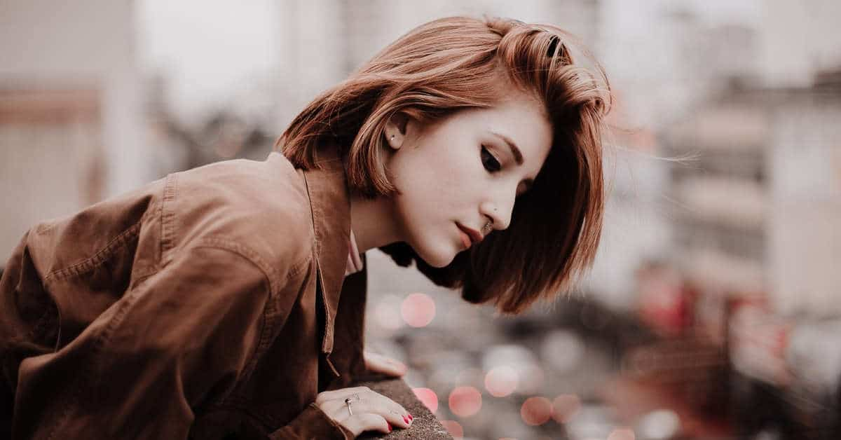 Woman looking over ledge